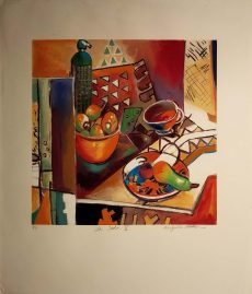 Lots of reds, oranges, browns and greens permeate a scene of a pear on a plate on a table and another fruit basket in the background.