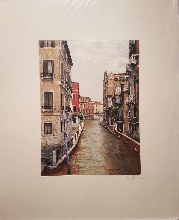 Beautiful aquatint of a view up a canal in Venice.
